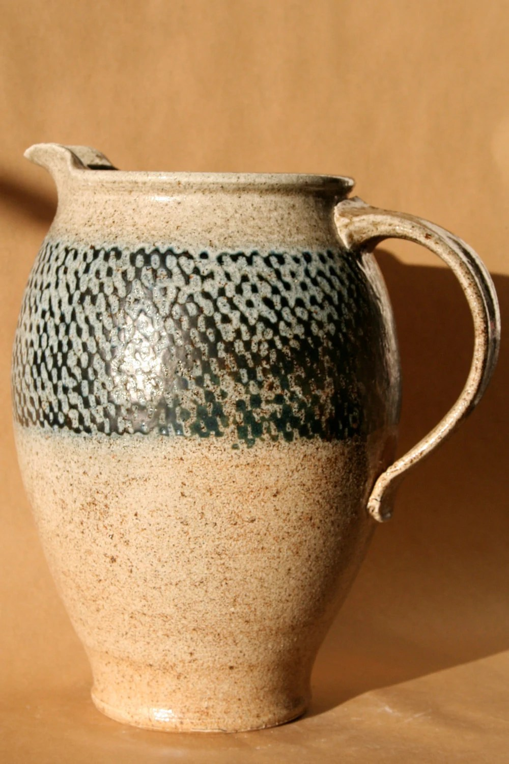 Saltfired, rope-inlayed tall Pitcher