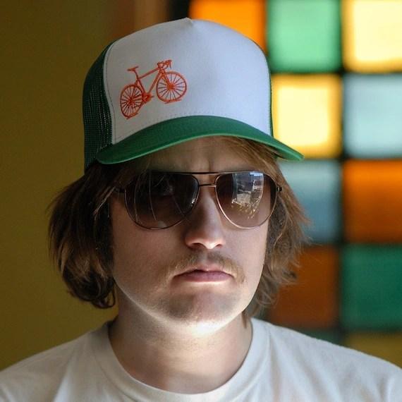 Vital Bicycle - trucker cap, orange on green