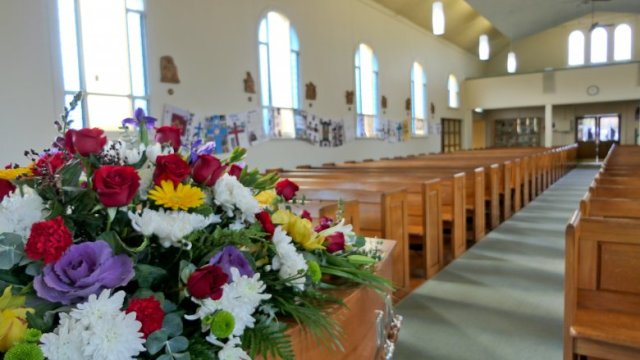 funeral flowers church pews
