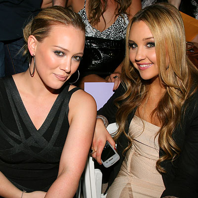 Teen idols Hilary Duff and Amanda Bynes proved their brand loyalty at the Herve Leger by Max Azria Bryant Park show in slinky designs from the line.