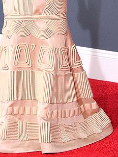 Appliquéd detail of her fishtail gown
