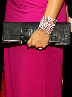 Lorraine Schwartz diamond cuff bracelet and Gucci clutch
