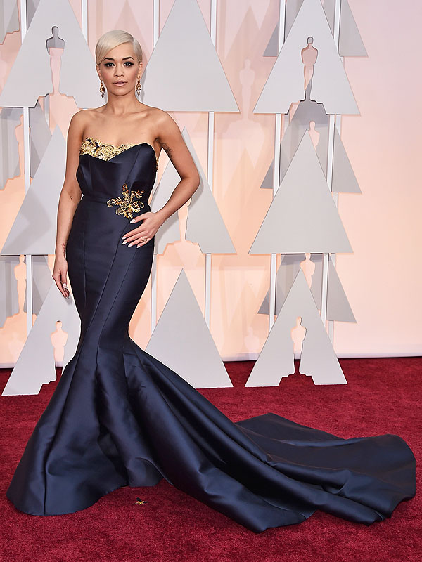 Rita Ora arrives at the Oscars on Sunday, Feb. 22,