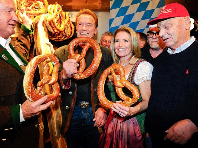 I'll Be Back: Arnold Schwarzenegger Wears a Traditional Outfit and Snacks on Pretzels During Trip Back Home to Austria with Girlfriend| Arnold Schwarzenegger, Patrick Schwarzenegger
