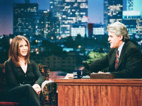Aniston's father is Greek and a native of Crete; she and her family lived there for a year when she was a child, which she discussed in a 1996 appearance on The Tonight Show.
