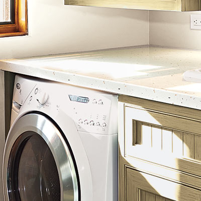 high efficiency laundry room with low care counter