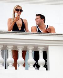 Paris Hilton cleavagy in low-sut swimsuit at the Copacabana Palace Hotel in Rio de Janeiro - Hot Celebs Home