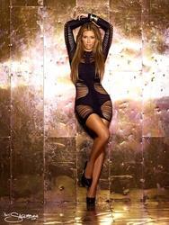 Kim Kardashian posing for Calendar 2011 photoshoot by N. Saglimbeni - Hot Celebs Home