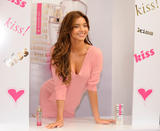 Miranda Kerr in pink mini skirt and pink blouse shows her legs and cleavage at launch of Victoria's Secret's Heavenly Kiss fragrance at the Victoria's Secret store at the Grove in Los Angeles