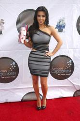 Kim Kardashian in tight dress showing off her ass as she launch The Kim Kardashian Vanilla Cupcake Mix - Hot Celebs Home