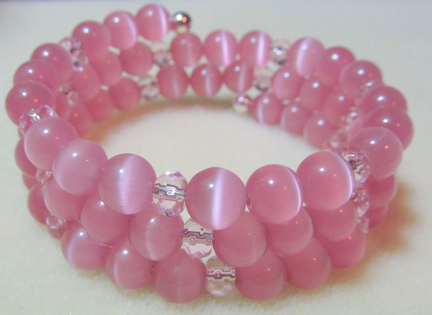 Bracelet - 8mm pale pink cat eye clear pink faceted rondelle glass bead memory wire