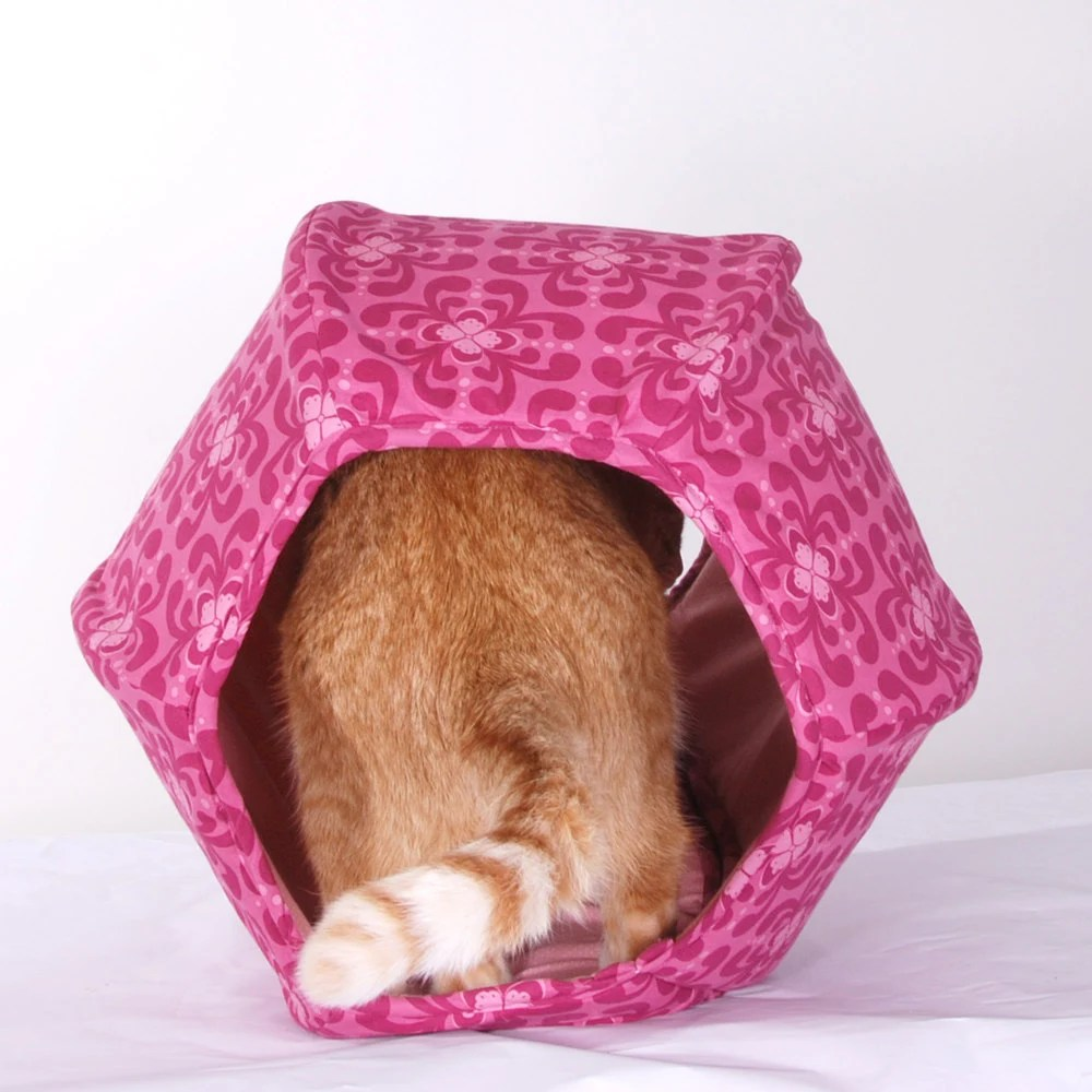 Cat Ball Hand Made Kitty Bed in Rose Pink Geometric Flowers ($61.00) by TheCatBall. For the modern cat in your life, how about a gift that keeps on giving - for both the cat and human. This one looks like it would be really fun!
