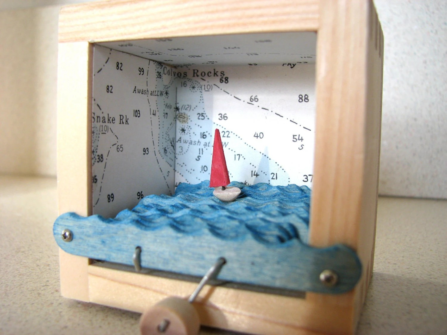 Kinetic Sculpture with Red Sailboat and  Nautical Charts - BeBraveMakeWaves
