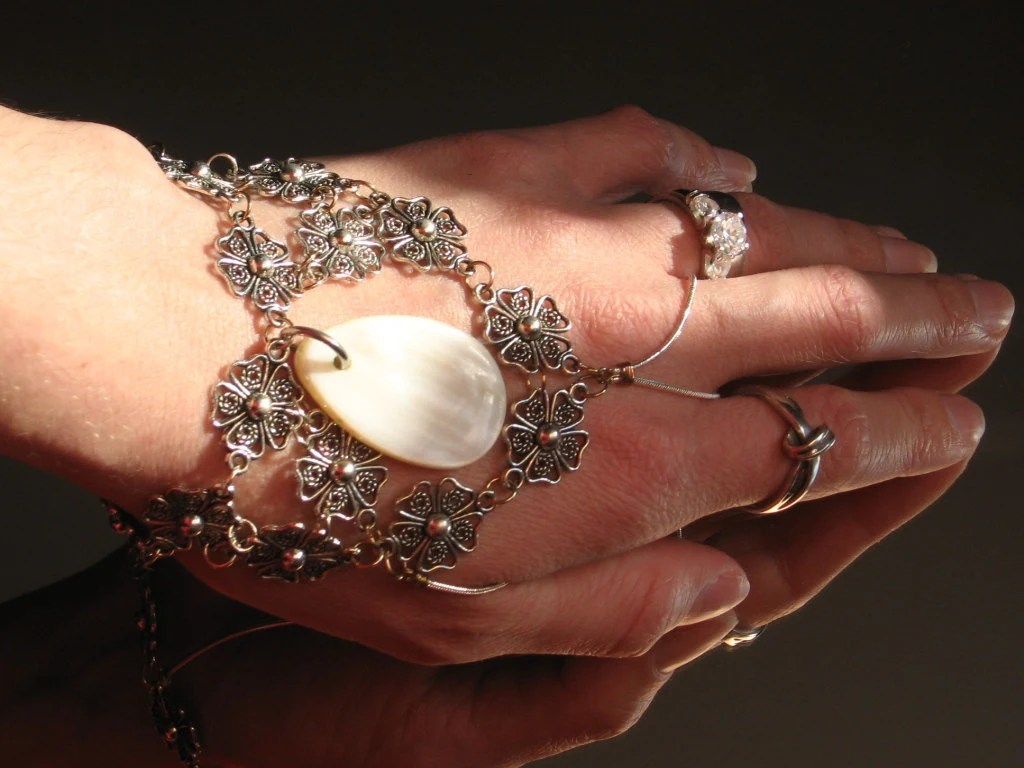 Flower Shell Slave Bracelet ring with a real Mother of Pearl Shell. Adjustable. Sterling Silver Snake chain & head pins.
