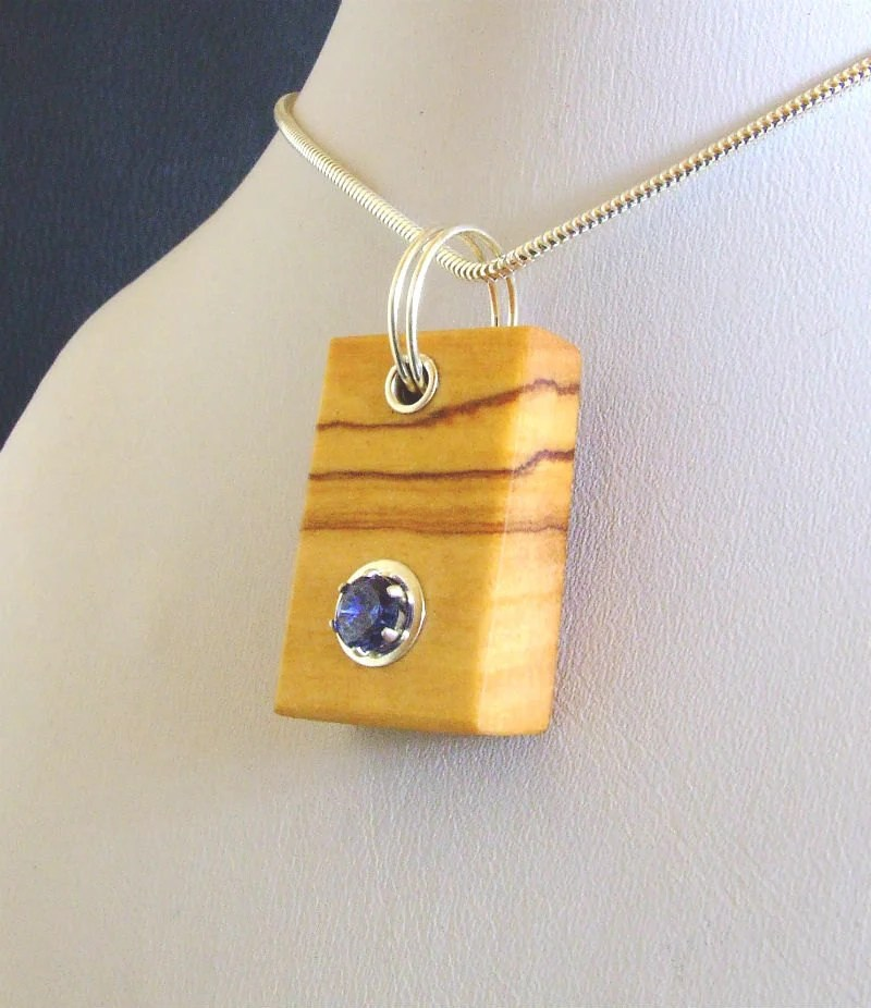 Wood pendant sapphire cubic zirconia in wild olive.