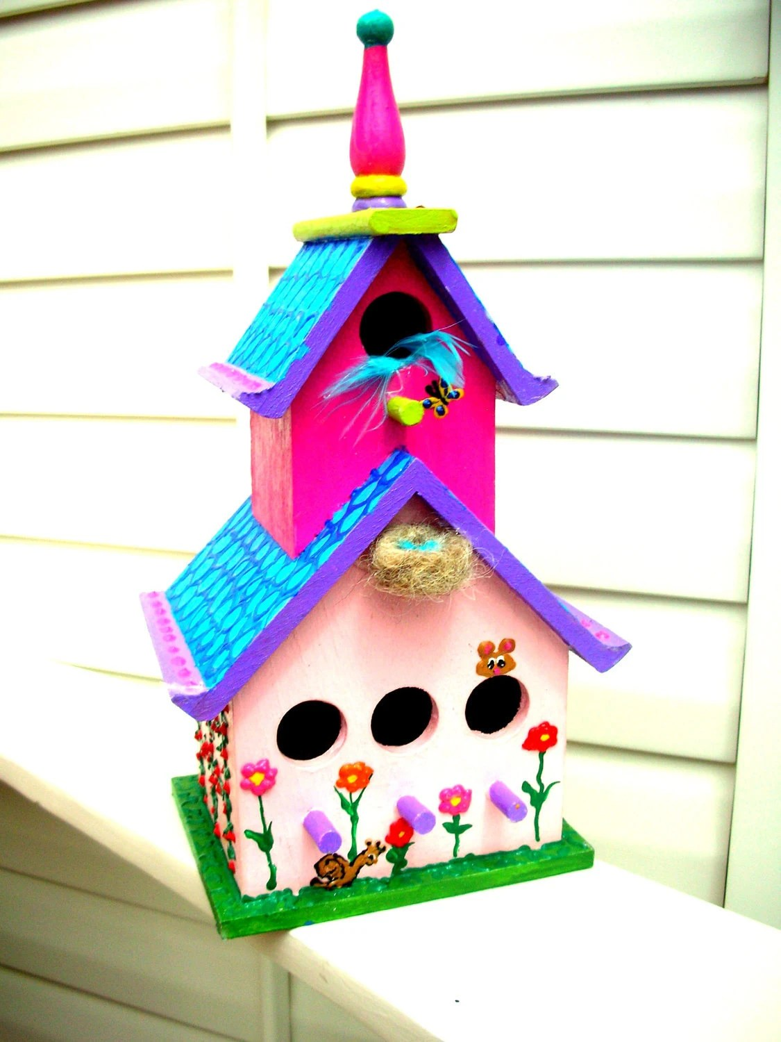 Bird nest with egss on a hand painted Bird house whimsical and happy hand