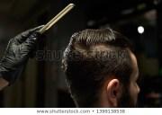 man brushing hair stock