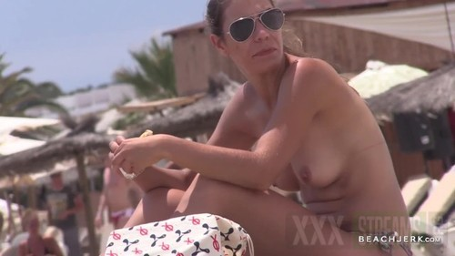 Natural titted mother eats her lunch topless on the beach