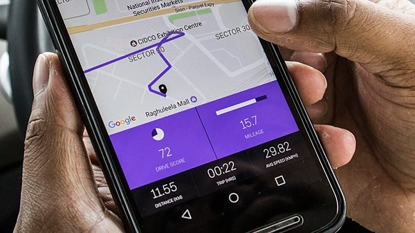 Image result for picture of a man tracking a car with mobile phone