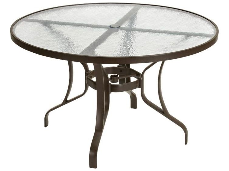 tropitone obscure glass cast aluminum 48 wide round dining table with umbrella hole