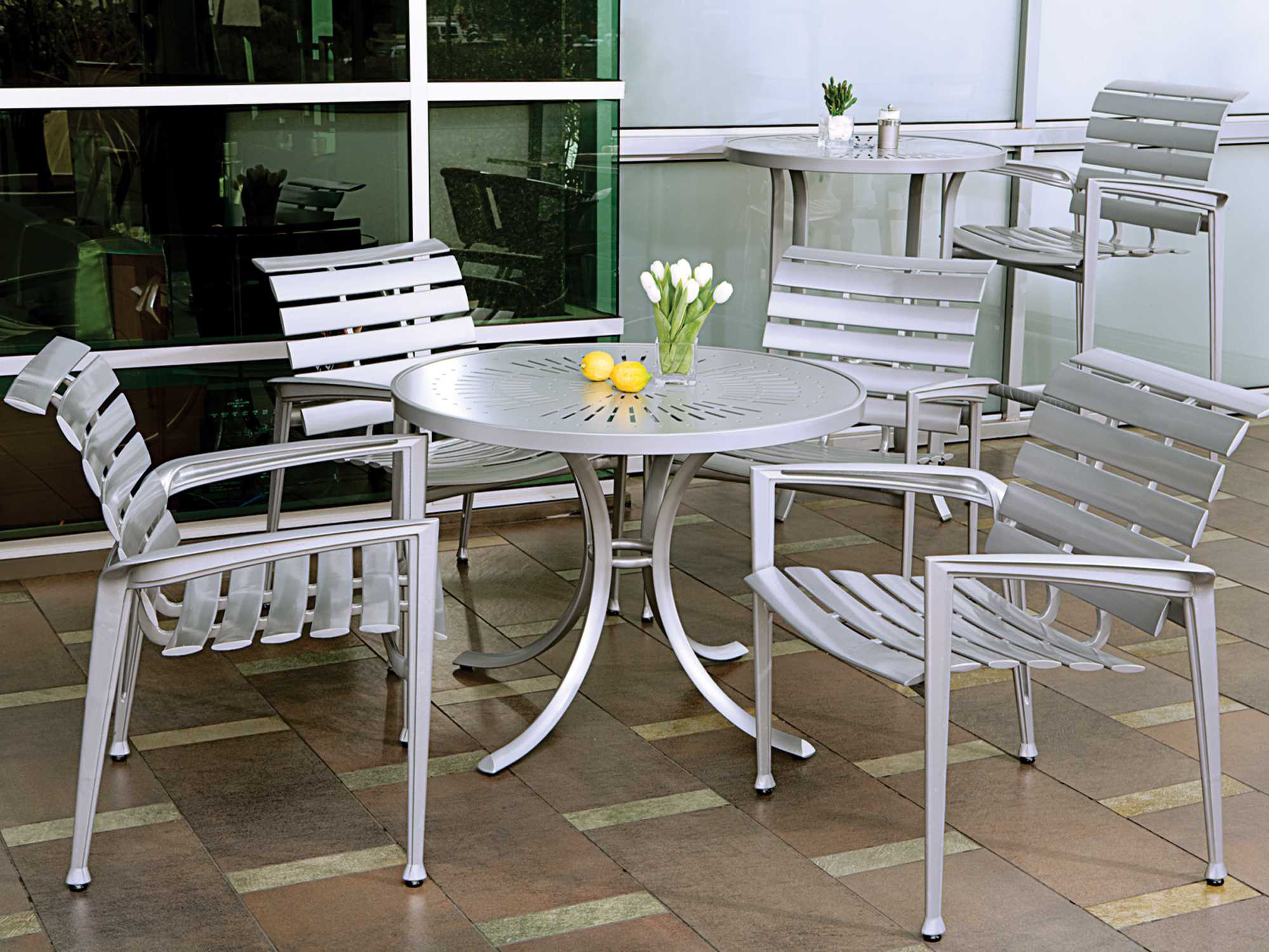 aluminum patio chairs stackable plastic tropitone veer cast dining chair tp680824