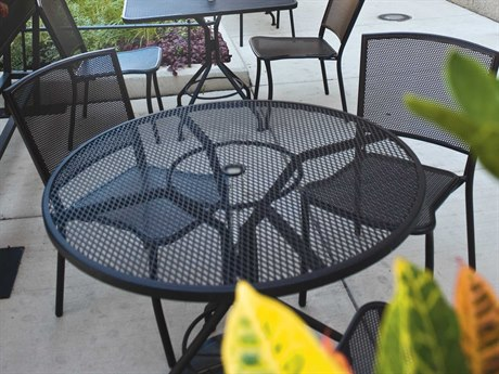 iron outdoor chairs ethan allen giselle chair wrought patio furniture made for longevity shop patioliving woodard albion dining set