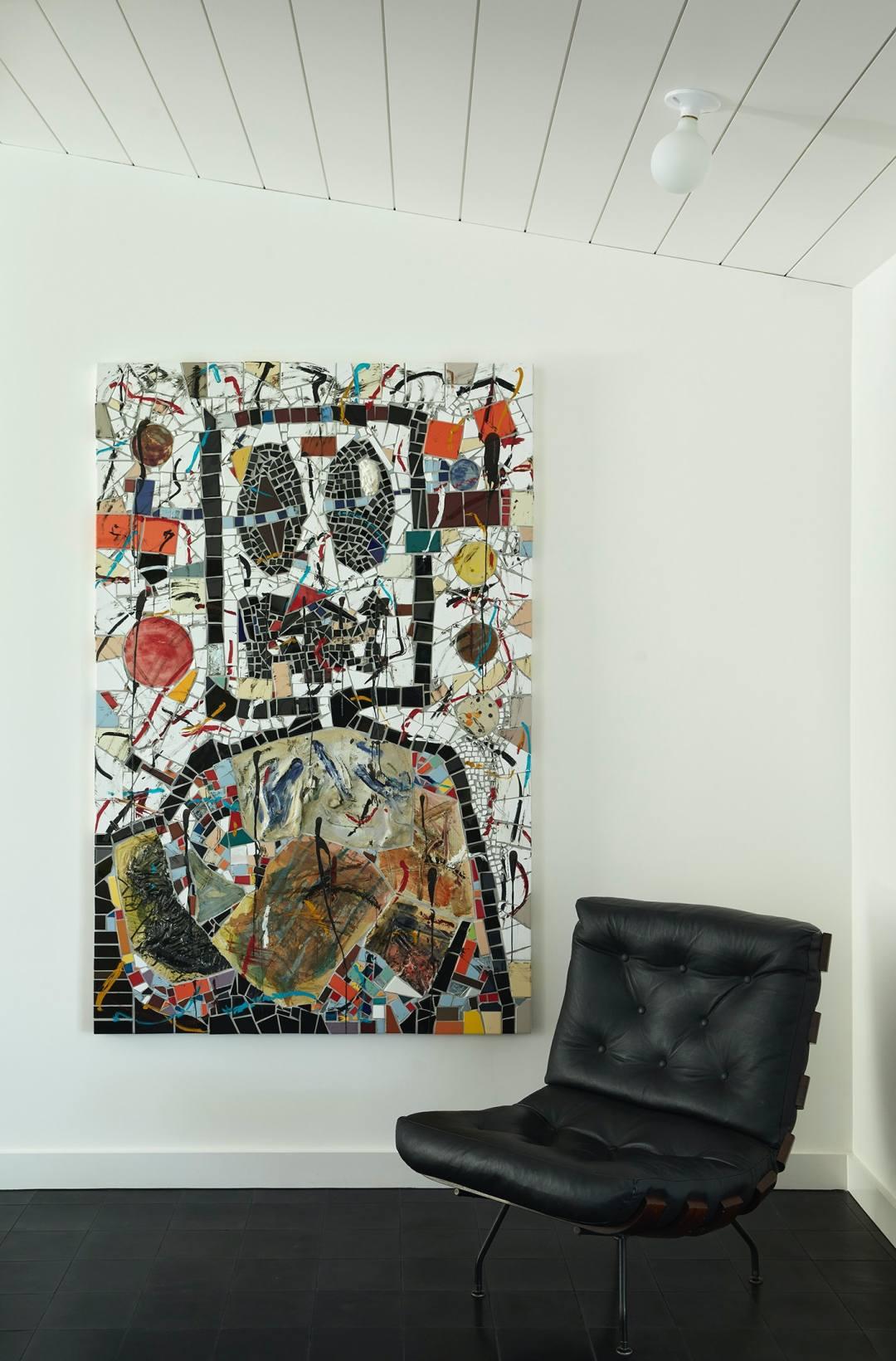 Rashid Johnson, Portrait of a Broken Man, 2020, next to a lounge chair by Carlo Hauner and Martin Ei...