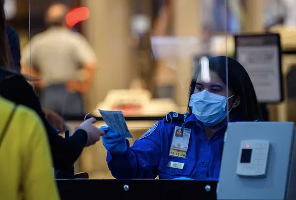 A passenger at Pittsburgh International Airport travels through security on May 7, 2020.