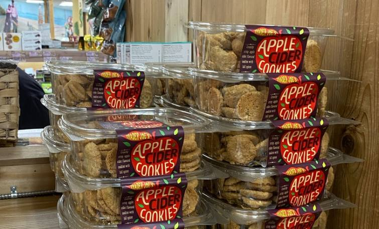 An image of multiple boxes of apple cider cookies.