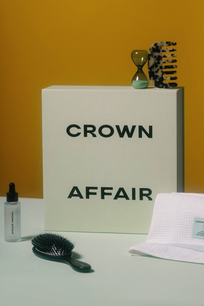 Brush, combs, oil, and towel from new haircare brand Crown Affair.