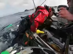 A shark drags a fisherman across the deck  Shocking!  The shark drags the fisherman overboard and capsizes his boat – WATCH