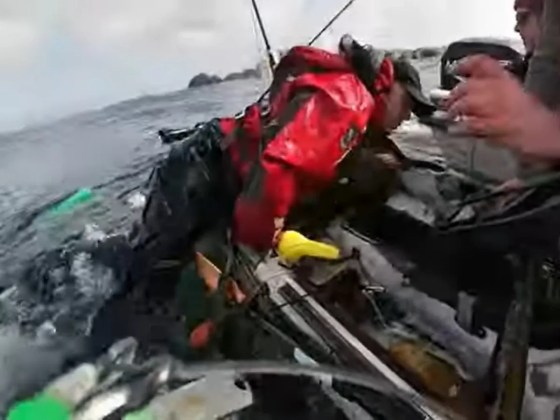 A shark drags a fisherman overboard