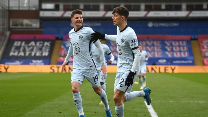 Kai Havertz of Chelsea celebrates with Mason Mount after scoring their team's first goal during the Premier League match between Crystal Palace and Chelsea at Selhurst Park on April 10, 2021 in London, England.