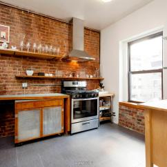 Shelving For Living Room Walls Swivel Chair Furniture A 32-foot Long With Exposed Brick Dominates ...