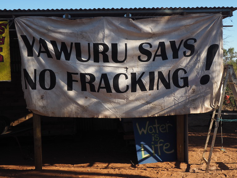 Signs near Buru Energy's Yulleroo fracking site in the Kimberley region of Western Australia. The site is currently inactive due a state-wide moratorium on fracking, but production could resume if the moratorium is lifted. Image by Nick Rodway for Mongabay.