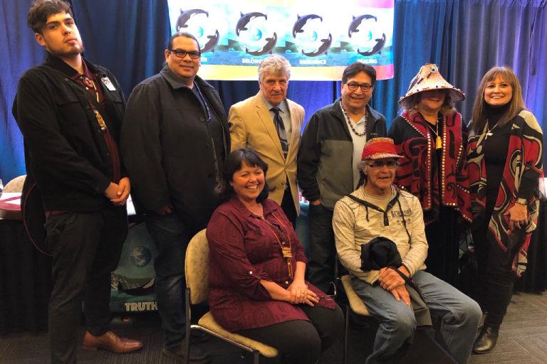From left: Cedar George, Reuben George, Kurt Russo, Robert Nahanee, Raynell Morris, Lisa Wilson, Ellie Kinley, Richard Solomon. Photo courtesy Lummi Nation Sovereignty and Treaty Protection Office.