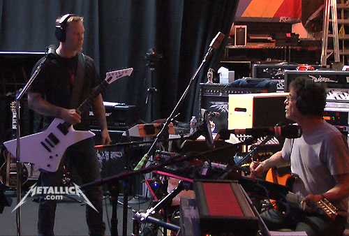 Lou Reed, seated right, in the studio with Metallica. Photo via metallica.com