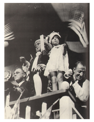 Baby Peggy waiving a flag on the stage at the 1924 Democratic National Convention. At far left is FDR.