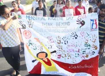 Women in Chennai holding an MH Day sign