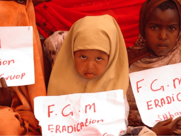 cutting girls is torture 2 little girls with signs that say stop FGM | www.imjussayin.com