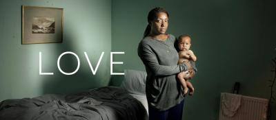 love - black woman holding a baby | www.imjussayin.com/whatson