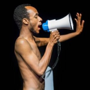 Whats On dogmatic black man almost naked with megaphone | www.imjussayin.com/whatson