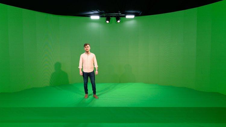 Person in green screen filming studios from Immersive AV