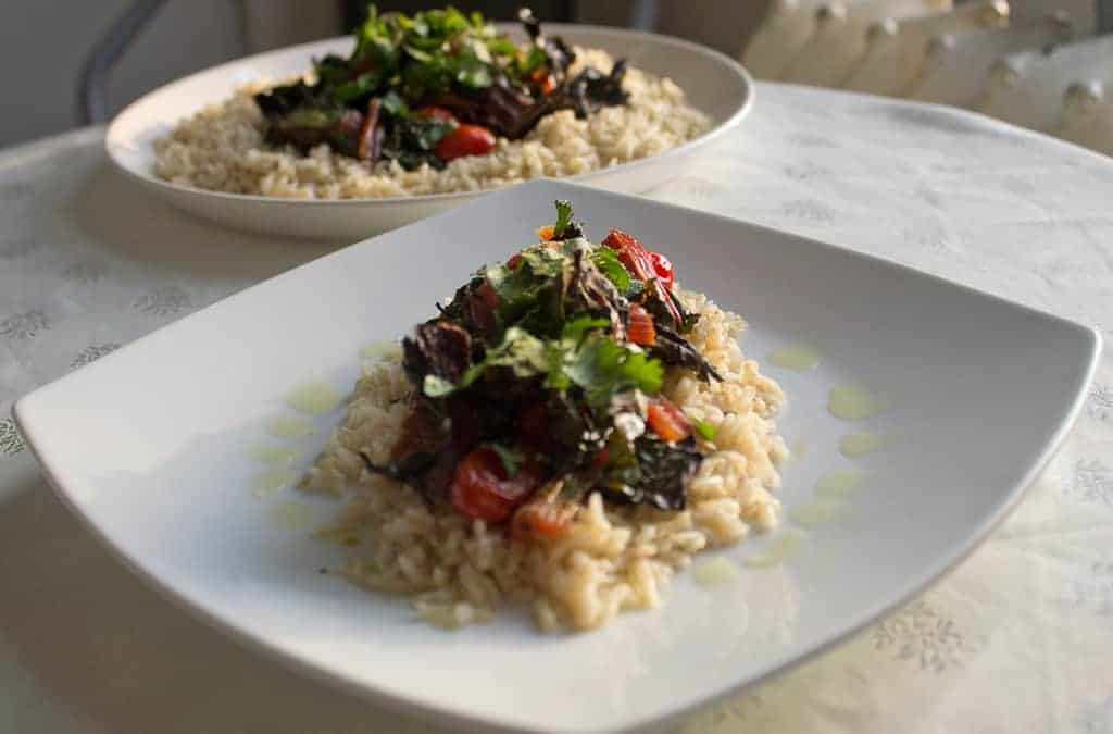 swiss chard and tomatoes on rice