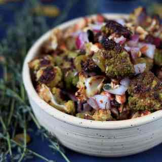 Roasted green cauliflower salad with onions, raisins and almonds