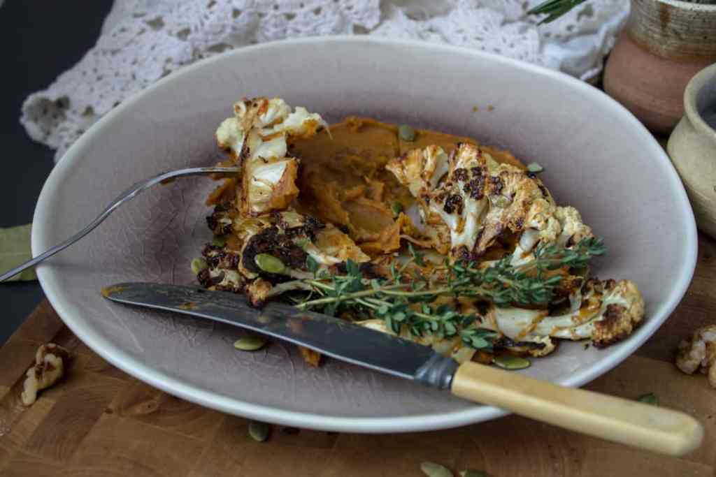 Roasted cauliflower steaks on spicy sweet potato puree