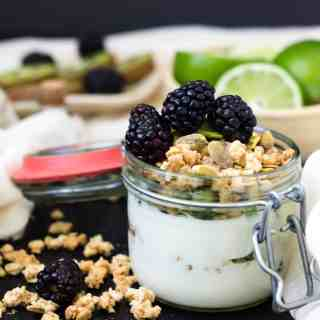 kiwi, lime and blackberry yogurt parfait with granola and pistachios
