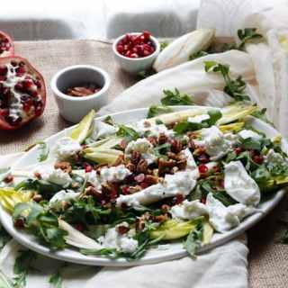 Arugula salad with endive, mozzarella, pecans and pomegranate seeds