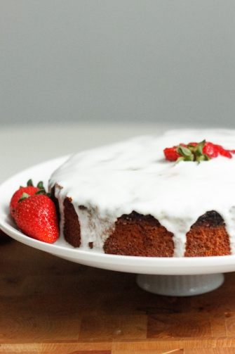 This lemon almond yogurt cake requires no special occasion, and minimal work. It's perfect to celebrate the weekend, especially if topped with strawberries.