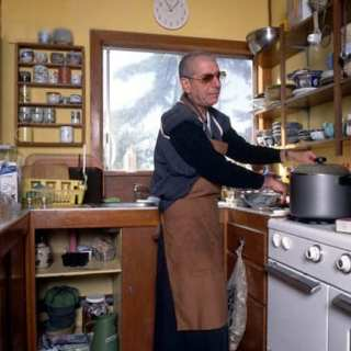 Leonard Cohen preparing food at Mt. Baldy Zen Center